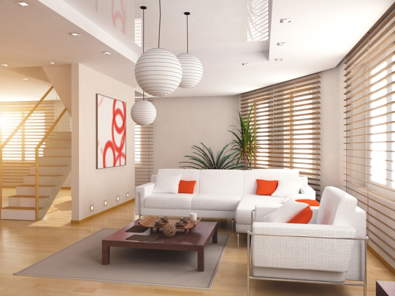 Neutral living room with a tiny bit of bright orange as a pop of color.