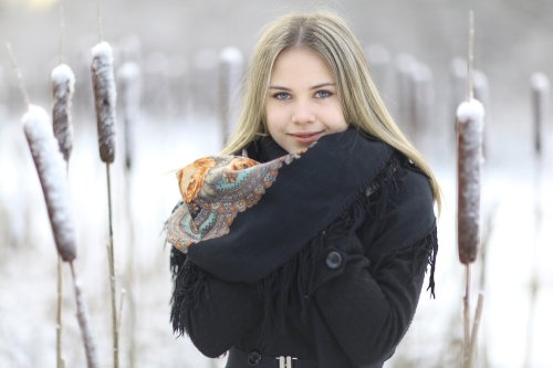 Young woman outside in snowy cold weather