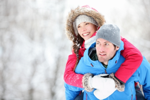 young couple outdoors during winter
