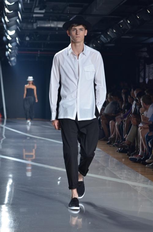 Fashionable young man walking the run way in keds