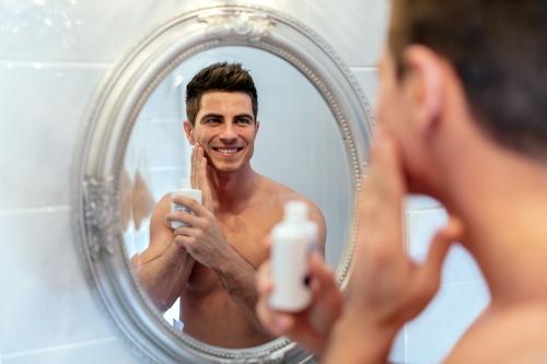 Man applying pre-shave serum