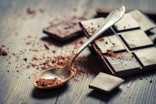 Dark chocolate bar and spoon with chocolate shavings
