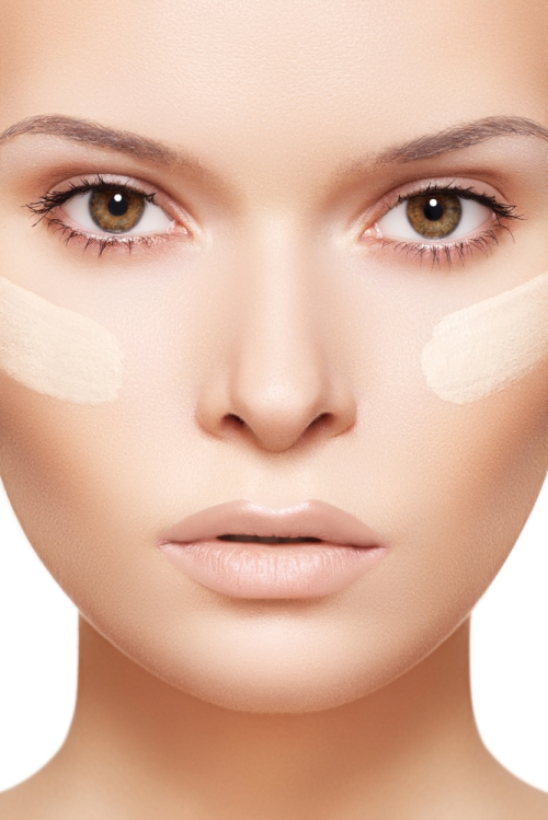 Young lady with foundation on her cheeks matching her skin tone