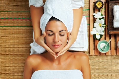 Woman receiving massage treatment at a spa
