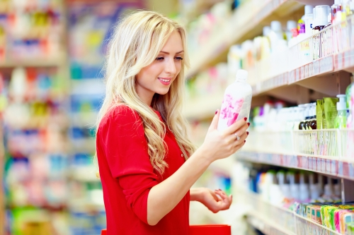 Woman choosing hair products