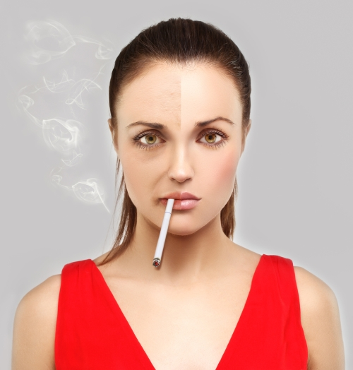 Woman smoking - shows effects on skin