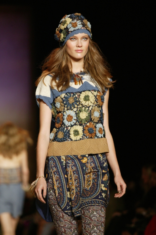 Model going down runway in mixed prints