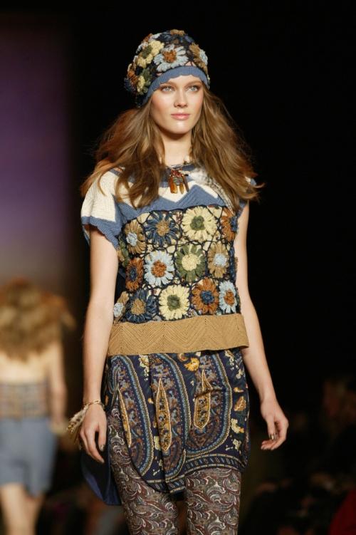 Model going down runway in mixed prints