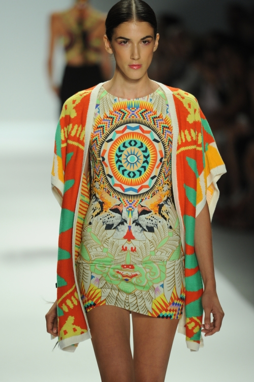 Model walking runway at fashion week; Mara Hoffman mixed prints