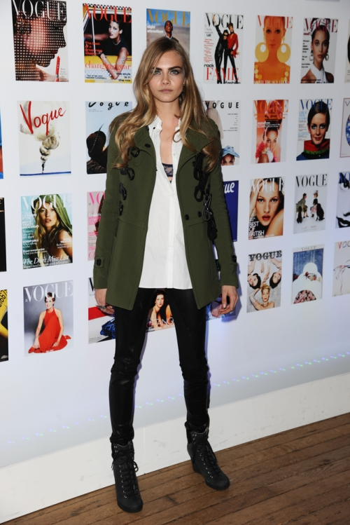 Model Cara Delevigne arrives at a party in a military style coat