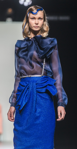 Maria Barros runway model showing off blue outfit