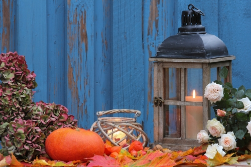 Fall tablescape with candles and pumpkin