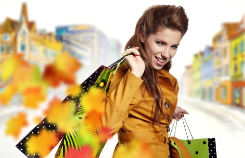 Young woman shopping during autumn