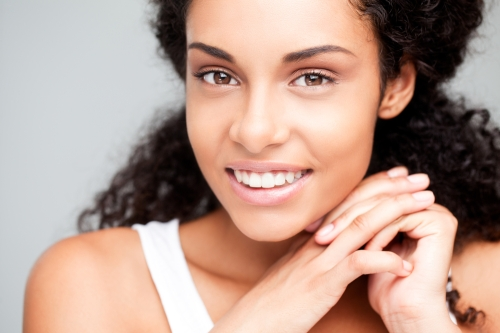 Happy young woman with beautiful skin