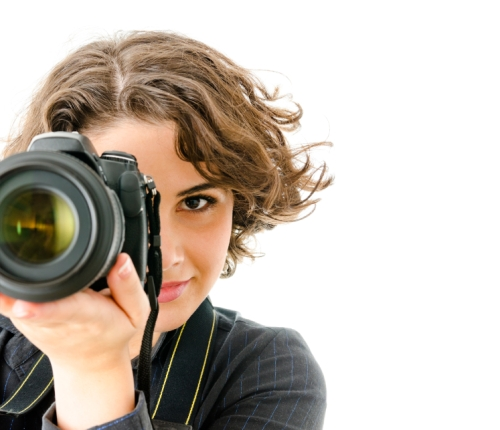 Young woman with professional  digital camera taking photographs