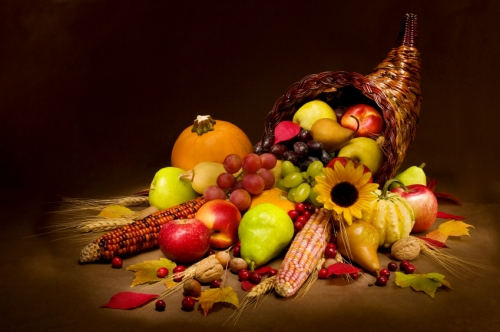Cornucopia  full of veggies and fruits and flowers for a tablescape