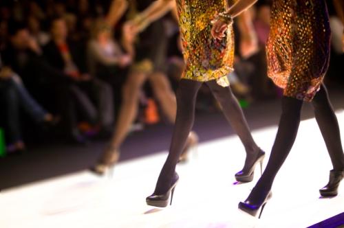Models walking down the runway