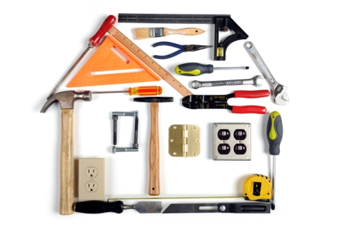 House made of tools over white background