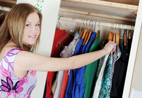 Woman updating her closet for spring.