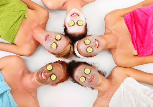Women enjoying a spa day with a facial.