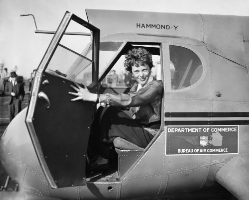 Image of Amelia Earhart sitting in a plane