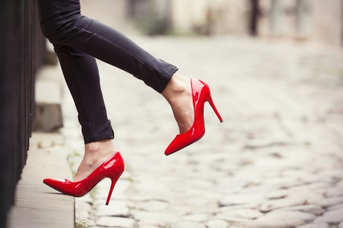 Woman wearing red colored heels.