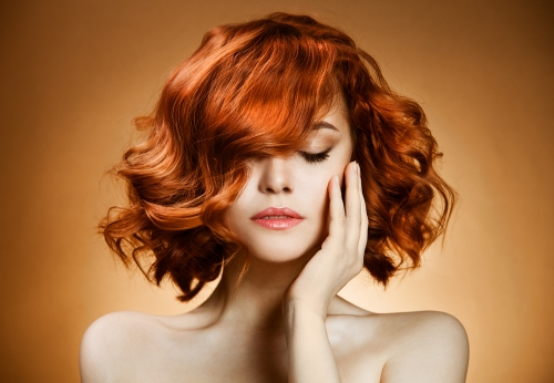 Woman with beautifully colored short hair.
