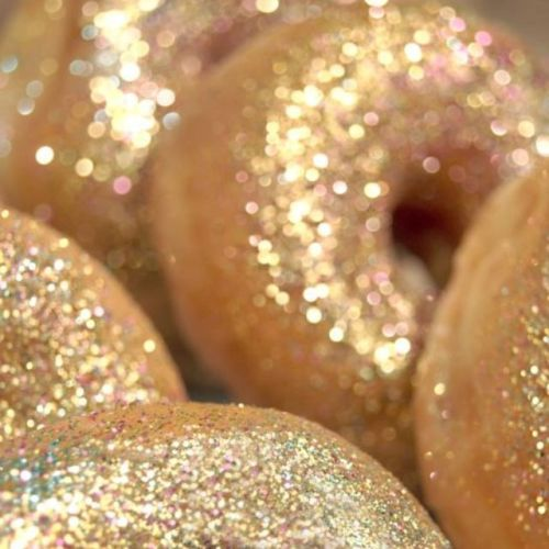 Glittering donuts being served at a house party.