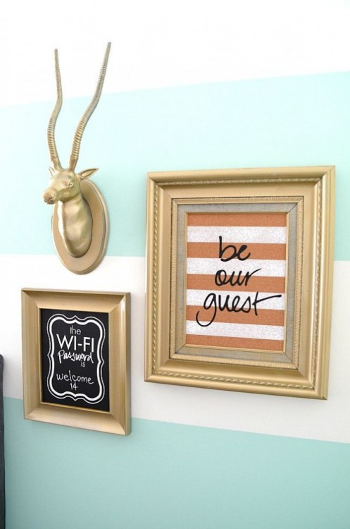 Beautiful photo frames and a fake beautifying the interiors of a home.