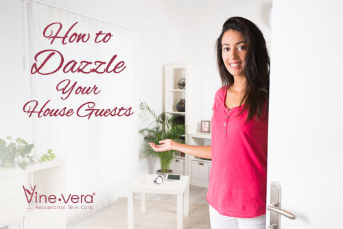 Woman inviting guests into her home.