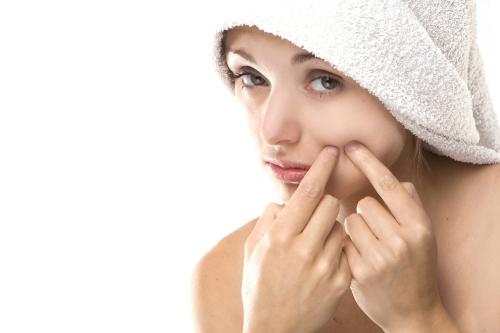Woman picking at her skin.