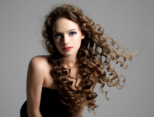 Woman with curly hair.