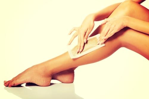 Woman waxing her legs.