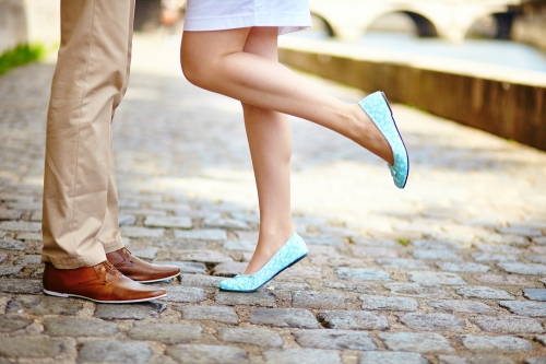 Woman wearing stylish ballet flats with her man.