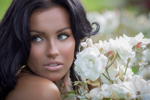 Woman with sallow looking skin due to overuse of spray tans.