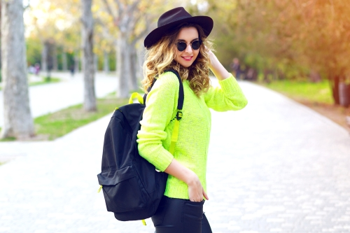 Fashionable woman with a leather backpack.