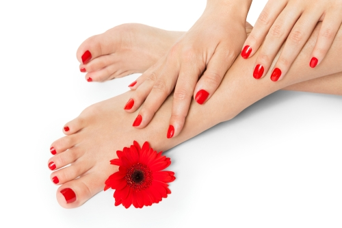 Woman with freshly manicured and pedicured nails.
