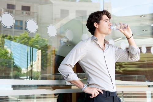 Business man having water