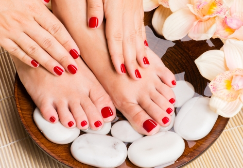 Woman enjoying a manicure and pedicure in a spa.