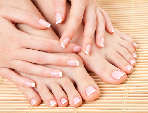 Woman with beautifully manicured and pedicured nails.