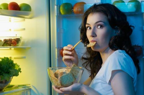 Woman enjoying a midnight snack.
