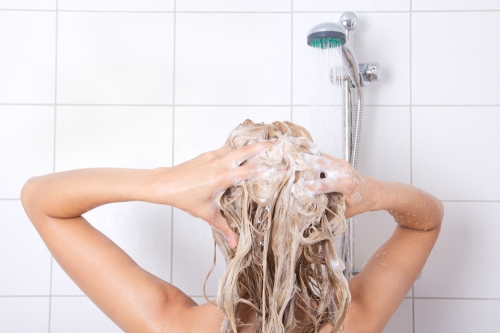 Woman shampooing her hair.