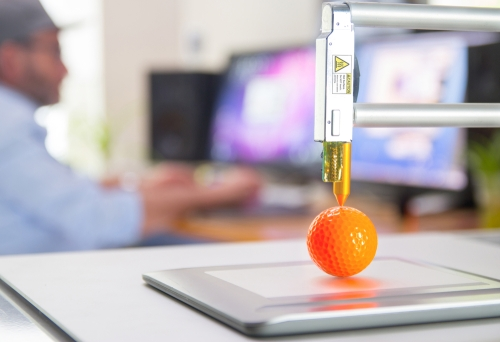 3D Printer printing a plastic ball.