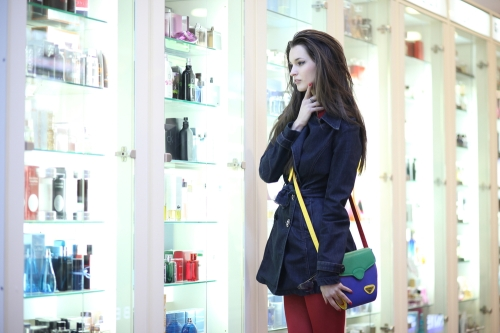 Woman choosing beauty products in a beauty store