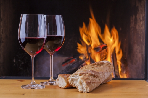 Red wine and bread by the fireplace.