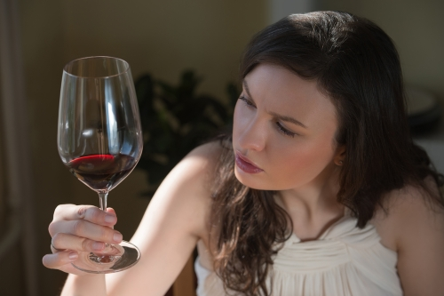 Woman drinking red wine.