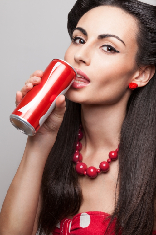 Woman drinking drink from a can