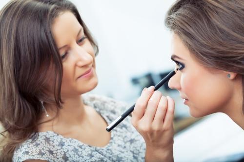 Woman applying kohl eyeliner