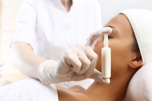 Woman using a skin serum.