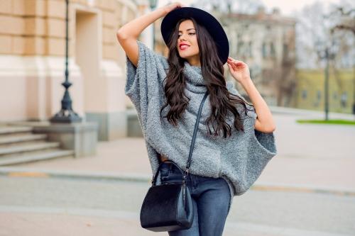 Woman wearing a sweater.